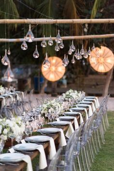 Ghost chairs and teardrop dangling lights: http://www.stylemepretty.com/destination-weddings/costa-rica-weddings/2016/08/22/cute-kids-donuts-special-destination-celebration/ Photography: 5ive 15ifteen - http://5ive15ifteen.com/