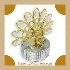 Szukacie pamiątkowego upominku dla malucha z okazji chrztu? Mamy dla Was wyjątkową propozycję! Przepiękna pozytywka przedstawiająca pawia z 24-karatowym złotem, zdobiona dziewięcioma kryształami Swarovski'ego. Nakręcana od spodu, gra śliczną melodię. http://prezentynachrzest.com/pozytywka_paw_swarovski_mozliwosc_dolaczenia_graweru,p,9942.html