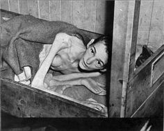 Dachau, Germany. An inmate lying on a bench immediately after the liberation of the camp, 1945.
