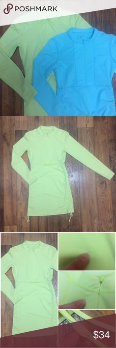 Athleta Light Green Ruched Rashguard Sherbet Green Rashguard from Athleta. Great piece paired with some printed bottoms or mix-n-match solids. Longboard enough for any height & adjustable with the cute ruched ties on the sides to fit the perfect length. Three flaws pictured above-one string has a part where stitching has come apart about the width of 2 fingers, 2 tiny pen sized spots (one on hip, one near zipper). MAKE ME AN OFFER!!! ☺️ Athleta Tops