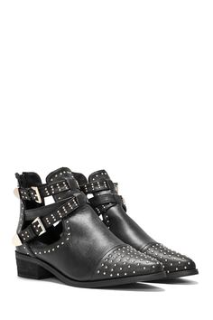 Cut outta sight. The Short Cuts Boot comes in vegan leather and features a low block heel, pointed toe, cut-out detailing at side, buckle closures, three straps at ankle, and pin stud detailing throughout.