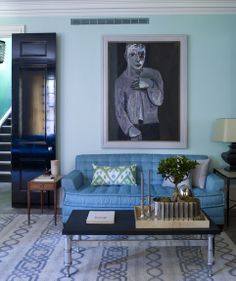 Steven Gambrel - I love his taste in art.  It has changed the way I see a room.