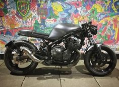 """Somebody took the right pill. """"Morpheus"""" by @jm_customs based on a Yamaha XJ600S. #xj600 #caferacer #builtnotbought #graffiti"""