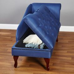 Chaise chairs are so chic to me. This one comes with storage space. Chic and practical!