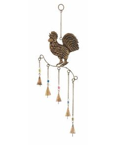 Metal Rooster Wind Chime with Cone Bells -  using a rooster figurine in your kitchen brings you good fortune. Hang this rooster-shaped wind chime up at your kitchen window! Its marvelous intricate craftsmanship adds rustic charm to your kitchen decor. With five cute conical bells suspended below the roosters perch from metallic links and colorful beads, this wind chime emits lilting sounds as the small bells clink together due to the flow of the breeze.