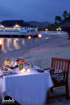 Dine under the stars with the sand between your toes at Sandals Halcyon Beach.