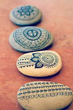 Paint rocks and sea shells for decoration use markers on wood