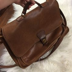 Vintage British Leather Coach Briefcase Gorgeous supple leather. Normal wear and tear adds to patina of bag. Cognac color. Messenger bag style Coach Bags Shoulder Bags