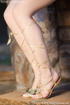 The women of the ancient era may wish to raid your closet when you arrive in our Ladies Roman Sandals. Footwear is a great way to stay in character from head to toe. Our Ladies Roman Sandals feature a gold lace-up sandal with a pair of golden leaves placed over the toe straps and below the knee on the ties. The gold leaf accents really add to the authentic ancient look. Our ladies Roman sandals are an ideal accessory for any Fairy, Greek, Roman, Egyptian, Renaissance or Goddess costume…