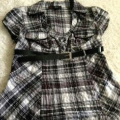 Black and white plaid top with accent belt High waist fitted plaid top with side zipper and accent belt with 'rhinestone' accent.  No known damage, lightly worn. Too small. HeartSoul Tops
