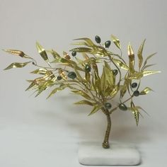 An olive tree, suitable for home or firm decoration, of whistles bronze handmade leaves and ceramic olives, on marble base. It can be also on iron base and inox or bronze olive leaves. Butterfly Tree, Olive Tree, Small Tables, Oak Tree, White Stone, Chara, Nice Things, Wooden Frames, Blessings