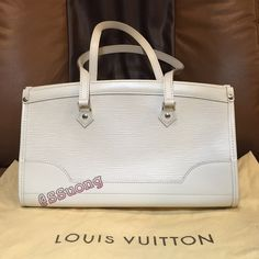 """✨SALELouis Vuitton Madeleine PM Authentic Louis Vuitton Madeleine PM shoulder bag in ivoire epi leather. Top is closed with zipper. Dimensions: 12.6"""" x 7.1"""" x 5.5"""" handles drop 7.9"""". Overall condition 9.5 of 10 Excellent pre owned condition with minimal sign of used=1 small minor scratch on back of the bag. Interior condition is very clean. Bag is like brand new &no odor. Bag will come with original dust bag and security tag for seller's protection. Use Posh Concierge service to authenticate…"""
