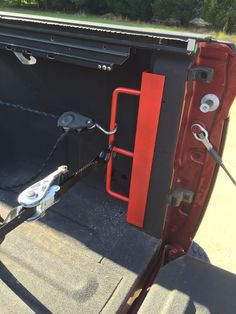 """Truck tie down made from 2"""" x 2 """" angle iron and some 1/2"""" rod bent so there is a 2.5"""" space over 12""""  with a tie in at 6"""" . Powder coated and bolted in with fender washers"""