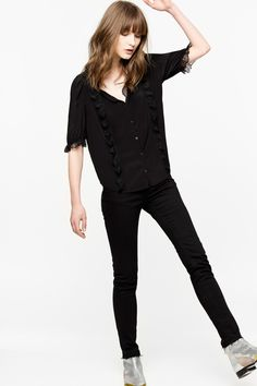 Zadig & Voltaire Deluxe short sleeved blouse, straight cut, embellished with lace on the neckline, on the sleeve and front, 100% silk. In the day and night, this feminine and elegant model will go with all your outfits. The Deluxe line includes exceptional pieces, sharp lines and noble fabrics.