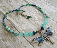 Dragonfly Necklace Upper Chakra Healing Crystal Blue Green Stone Animal Totem Lapis Chalcedony Amazonite Peru Opal Aventurine Pyrite Brass Item #MX017N  Mariposa Stone Works original --💜-- one of a kind!  Me and my butterflies and dragonflies...I just love them! This particular dragonfly is special because it was hand painted by one of my favorite local polymer clay artists, Peg Harper. And a lovely job she did too! This dragonfly was the jumping off point of this necklace as I endeavored…