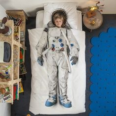 "Astronaut Duvet Turns You Into A Spaceman. The kid in me says, ""Holy moly, spaceman covers!"" The adult in me says, ""Holy shit! ASTRONAUT DUVET!!!:"
