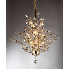 This chandelier is definitely the definition of beauty and function. This will brighten up the room and improve the ambiance with its features and style. Its crystals are like leaves extending to any