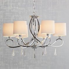 Stir things up in the dining room or bedroom with the Chrome Swirl chandelier.