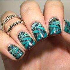 Aqua swirl nails
