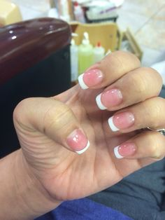 French manicure with thin white tip powder with medium pink powder.