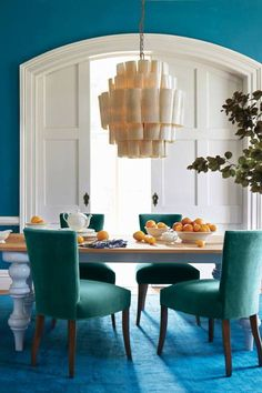 """Turquoise walls in a dining room. Blythe Dining Table. Anthropologie.   For more of this trend, follow Jill Jordan's board """"Jewel-toned Rooms"""""""