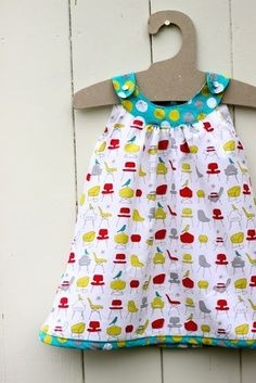 Snappy Baby Dress to-sew     so cute could make this in cottons for spring and summer, or corduroy for winter!