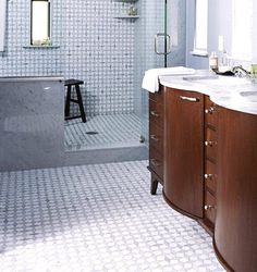 This intriguing geometric-pattern tile covers the floor and the back wall in the wet room. Continuing the pattern from the floor up the wall gives the illusion that the room is larger than it really is. Wet Room Bathroom, Compact Bathroom, Small Bathroom, Bathroom Ideas, Dream Bathrooms, Bath Ideas, Bathroom Remodeling, Bathroom Storage, Bathroom Inspiration