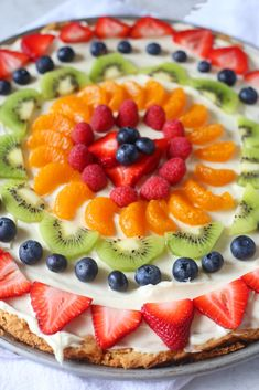 This Sugar Cookie Fruit Pizza recipe is made with a sugar cookie crust, cream cheese frosting, and topped with various fruit of your choice. This is the perfect summer dessert. Fruit Pizza Cookies, Sugar Cookie Pizza, Fruit Pizza Bar, Easy Fruit Pizza, Sugar Cookie Dough, Dessert Pizza, Sugar Cookies Recipe, Cookie Recipes, Dessert Recipes