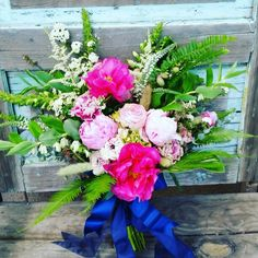 Whimsical bouquet of peonies, ranunculus, hydrangea, bunny tail grass, ferns, astilbe, veronica,  foxglove,  spirea and Solomon's seal. Designed by Anna of Fleurt Floral Art.