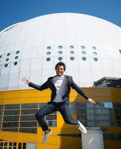 Amir, the singer representing France at Eurovision 2016, strikes a playful pose in front of the Globen Arena in Stockholm, Sweden, home of this year's contest.