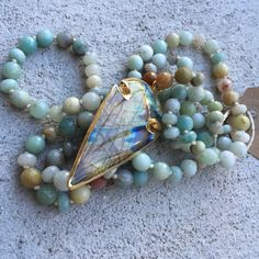 Hand Knotted Amazonite Necklace + Labradorite Arrowhead by ReaganPorterDesigns on Etsy https://www.etsy.com/listing/252545434/hand-knotted-amazonite-necklace
