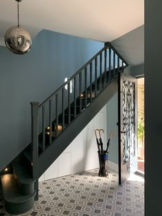 Geometric Tiles, umbrella stand and dark staircase! Geometric Tiles, umbrella stand and dark staircase! Narrow Staircase, Narrow Entryway, Floating Staircase, Staircase Design, New Staircase, Painted Staircases, Painted Stairs, Tiled Hallway, Dark Hallway