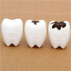 """white teeth eraser from Japan by Iwako by Iwako. $1.39. by Iwako. erasers can be put on pencils. kawaii eraser from Japan. collection: """"Teeth"""". with happy, sad and unhappy tooth with caries. cute Japanese eraser"""