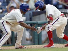 Jimmy Rollins (right) celebrates his two-run home run against the Cardinals with Ben Revere. (Yong Kim/Staff Photographer)