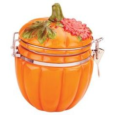 Hand-painted earthenware jar with a pumpkin shape and a locking air-tight lid.  Product: Hinged jarConstruction Material: Earthenware and metalColor: Orange, green and redFeatures: Hand-paintedAir-tight lidDimensions: 6 H x 4.25 DiameterCleaning and Care: Hand wash recommended