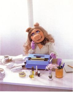 Miss Piggy - looking glam at her typewriter                                                                                                                                                                                 More