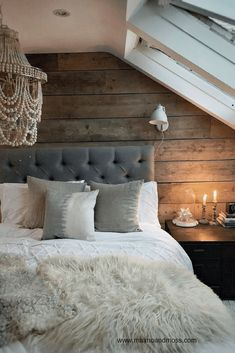 A guide to how to create a successful loft conversion with warm, texture and light.  Use a scaffold plank wall in your bedroom to add texture and warmth. #veluxloftwindows #loftconversion #loft extension #loftconversionideas