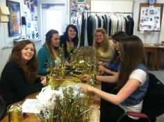 The Fashion Production class making centerpieces for the reception