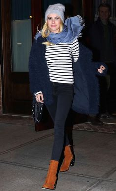Emma Roberts in a striped shirt, blue scarf, navy coat, skinny jeans and brown boots - click through to see more celebrity winter outfit ideas