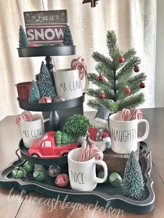 Rae Dunn Christmas decor #raedunn #raedunnclay #raedunnmugs #tieredtray #tablescape #tabletop