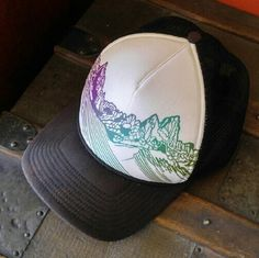 Patagonia Mountain Peaks Trucker Hat Excellent condition, little to no wear. Vibrant colors in mountain design. Only discoloration is on brim and inside front brow. Brim is very slight and may be for effect. Brow is far more visible in photo than actual (tried to find lighting that would show it, but the photo exaggerates it). Sizing isn't marked, best to assume men's or unisex for trucker style hats, in my experience, but that is also part of 'the look'. Patagonia Accessories Hats