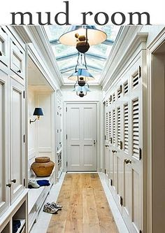 """Looks almost too nice to be the """"mud- room-entry"""" to a laundry room, and I'm not sure how practical it would be, but I do love the storage-behind-doors (louvered for ventilation), and the natural wood floor.  Even the skylight is gorgeous.  I would make it a bit wider, put a cushion on the bench, and provide under-bench shoe storage."""