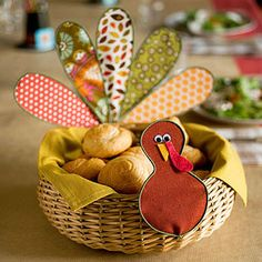 Well-Dressed Turkey: This bird's fancy feathers are made from scraps of fabric and floral wire. Attach the plumage to a bread basket to create a functional centerpiece.