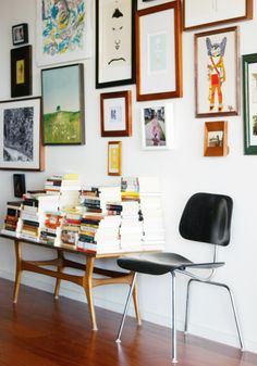 Gretchen says: A wall of art and a pile of books. Be true to you.