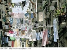 Hanging laundry in street at Spaccanápoli (´Split of Naples´) area, old town. Naples. Italy