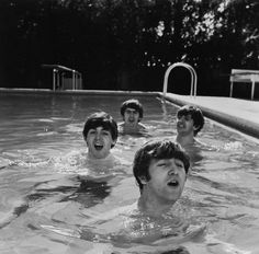 four lads from liverpool - paul mccartney, george harrison, john Lennon, and ringo starr - take a dip in an unheated miami beach swimming pool during a cold snap on their first trip to the states.
