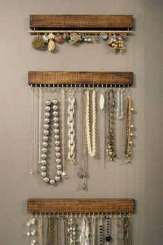 Wood with hooks and rods, so pretty, simple and cheap. Love it