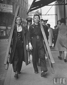 During WW1 and WW2 women really had to work all the jobs normally considered for men only. Here we have two ladies on window cleaning duties.