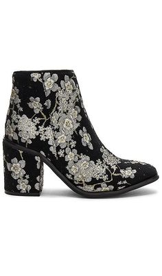 The Best Floral Ankle Boots to Buy This Fall via @WhoWhatWear