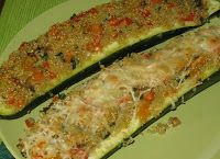 Quinoa Stuffed Zucchini      This can be served as a side dish or as a main meal.  A great way to use up all that zucchini in your garden.  You can also make it with smaller zucchini's.  Or try it with diced zucchini and mix it in with the mixture.